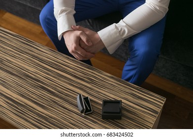 Wedding day. Man's hands and cufflinks on the table.
