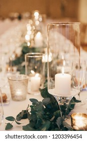 Wedding decor with candles and eucalyptus
