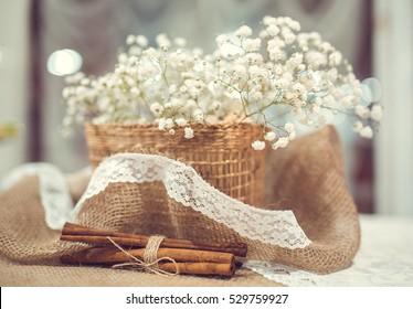 Wedding decor of cinnamon and basket with flowers gypsophila