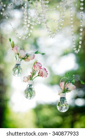 Wedding decor with  flowers of eustoma in bulbs. Decoration of a wedding photoshoot. Vertical.