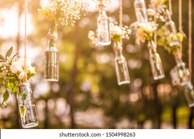 Wedding decor, glass flasks in the forest.