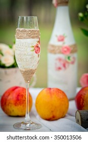 Wedding decor with wedding glass in style of a shabby chic, bottles, peaches. Decoration of a wedding photoshoot.  Details of a wedding decor.