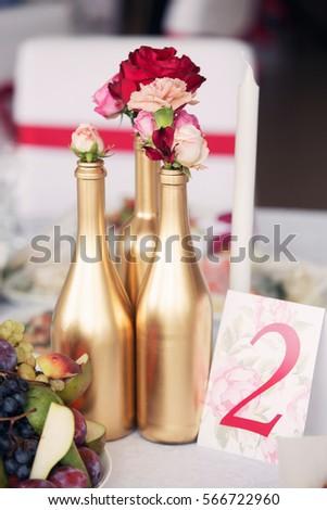Wedding Decor Golden Bottles Red Roses Stock Photo Edit Now