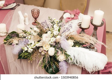 wedding decor on tables in the restaurant's interior - flower arrangements