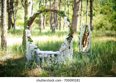 Wedding decor. Scenery for a wedding photoshoot in the forest. The big ring wattled of a rod and white florets