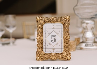 Wedding decor with table number in golden frame