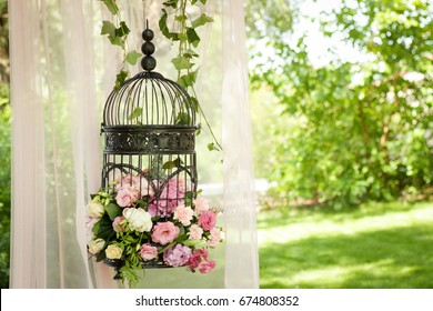 Wedding decor, decor in the trees, flowers in black cages