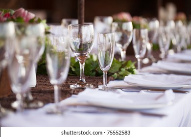 Wedding decor, wine glasses and champagne flutes on table. Selective focus