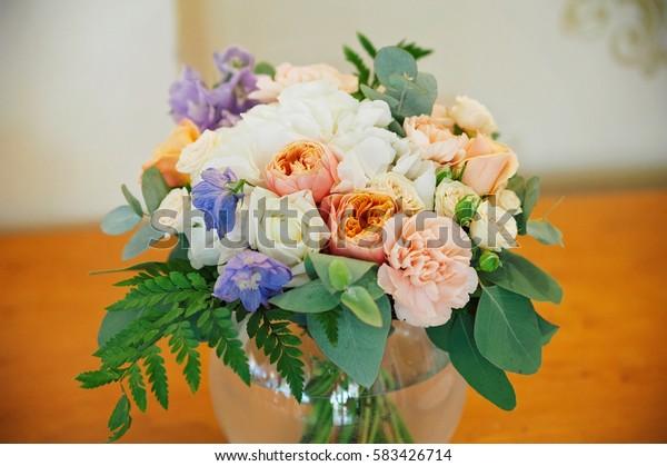 Wedding decorating bouquet of roses and petals, closeup