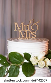 Wedding decoration, cake topper, Mr and Mrs. White cake with green leaf