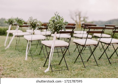 wedding decoration chairs in rustic green style. Wedding in Italy. fine art wedding photo.