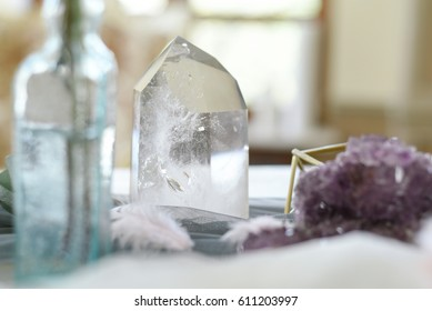 Wedding decoration with ,crystals, pink quartz, amethyst, rock crystal, floristry and serving