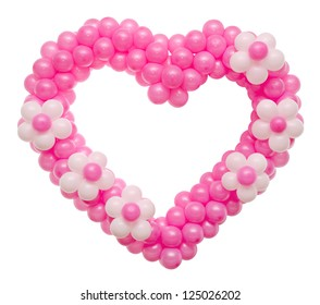 a wedding decoration - many pink balloons in a heart shape