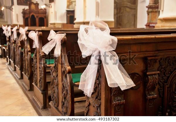 Wedding decoration on wedding ceremony. Wedding arrangement inside of church.