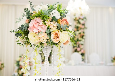 Wedding decoration on table. Floral arrangements and decoration. Arrangement of pink and white flowers in restaurant for luxury wedding event.