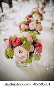 Wedding decoration on table. Floral arrangements and decoration. Arrangement of pink and white flowers in restaurant for event
