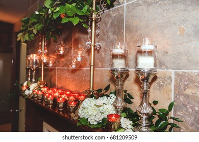 Wedding decoration on table. Floral arrangements and decoration. Arrangement of white flowers and candles in restaurant for luxury wedding event