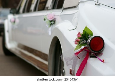 wedding decoration on a white limousine