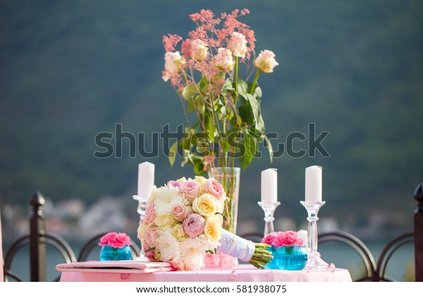Wedding decoration table with bridal bouquet and candles