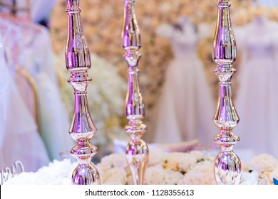 wedding decoration, Three cristal pillars on a white blurry  background with white flowers.