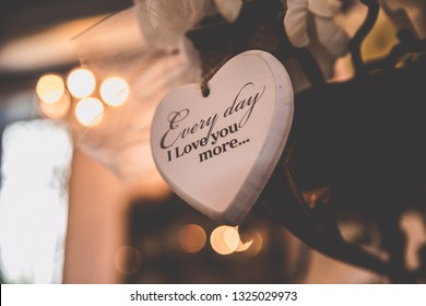 """wedding decoration, wooden heart with a love text saying """"Everyday I love you more..."""""""