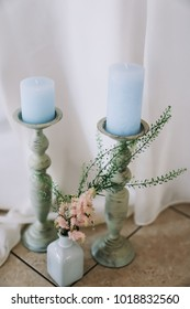 Wedding decoration.Blue candles in candlesticks. Wedding inspiration. Wedding background