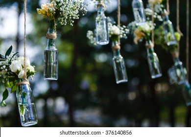 wedding decorations Luxury original wedding floral decoration in the form of mini-vases and bouquets of flowers hanging from the ceiling