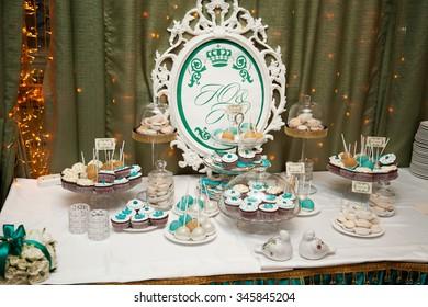 wedding decorations: macaroons, cake, muffins. Birthday party. Celebration.