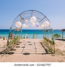 Wedding decorations on a beautiful sunny day by the beach and ocean