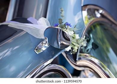 Wedding decorations on a vintage car
