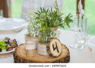 wedding decorations for table in rustic style,  wooden desk,  jar,  number 4