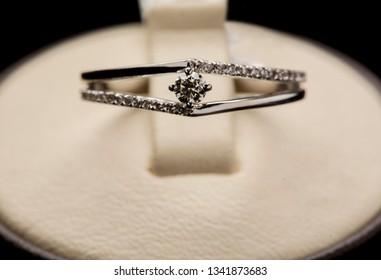 wedding diamond ring on white display