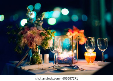 Wedding dinner by candlelight. Wedding decorations at night.