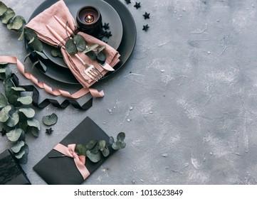 Wedding dinner design. Light pastel colored tableware set: plate, vintage silverware on rustic shabby wooden background