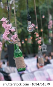 wedding diy decoration with bottle, flowers, and bulbs outdoor idea