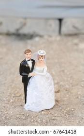 wedding doll couple on street background