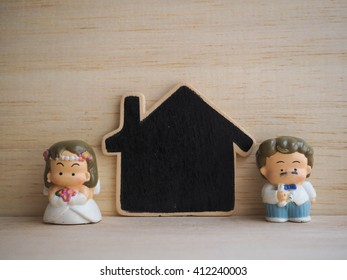 Wedding doll on wood background