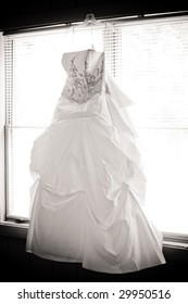 the wedding dress against the window