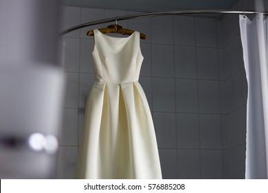 wedding dress in the bathroom