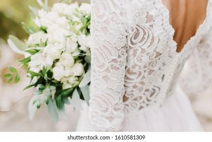wedding dress. bride holds a wedding bouquet, wedding details