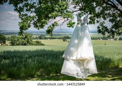 Wedding dress, closeup of wedding dress in room, nobody