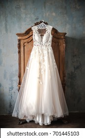 Wedding dress is hanging on the closet. Stylish photo