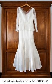Wedding dress hanging on the cupboard