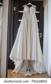 Wedding dress hanging on the door