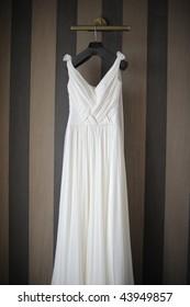 Wedding dress hanging on a shoulder