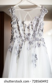 Wedding dress hanging in the room.