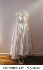 Wedding dress hangs on the wall