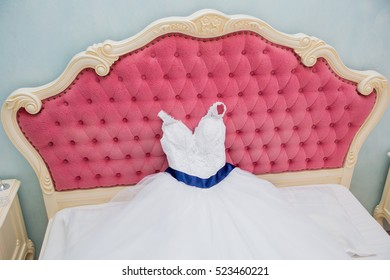 Wedding dress is lying on the bed