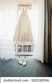 Wedding dress on a hanger in the bride's room