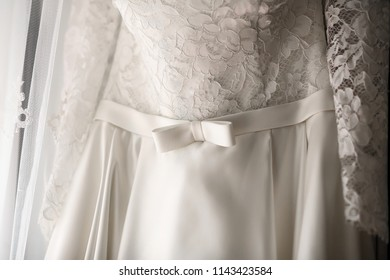 Wedding dress on hanger.  Bride's dress.
